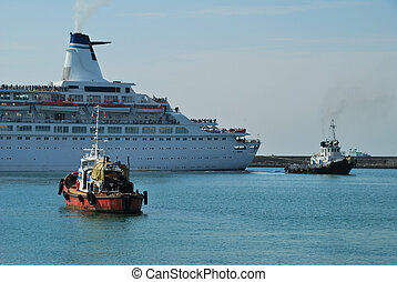 Towage of the steam-ship - Towing of ship in port of Sochi,...