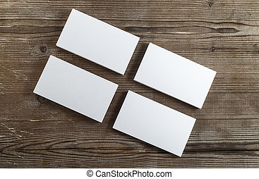 Business cards - Photo of blank business cards on a dark...