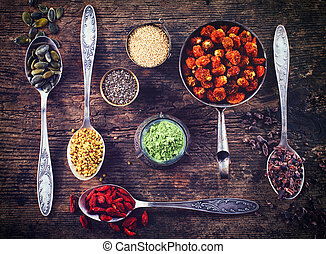 Superfoods - Various superfoods on wooden background