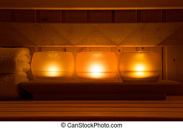 Sauna equipment - Close-up image of candles in a wooden...