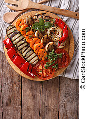 Grilled vegetables on a board. vertical top view - Grilled...