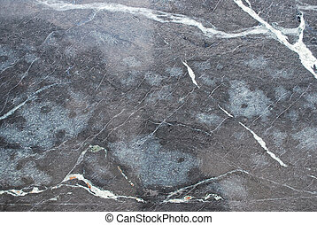 grey and black marble floor with interesting structure