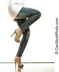 woman legs in denim trousers high heels shoes - Fashion and...