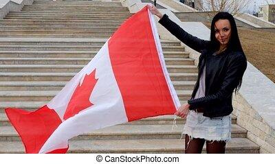 Brunette girl with Canadian flag outdoors - Brunette girl...