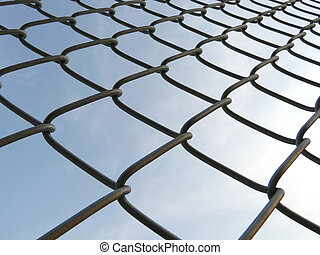 Wired mesh fence - wired mesh fence in sky background
