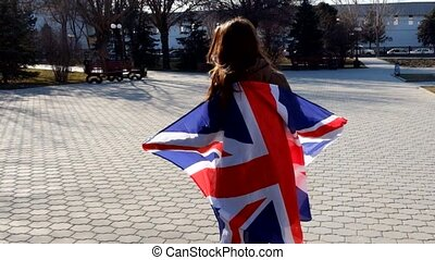 Camera To Girl, Wrapped In Union Jack Flag and turning...