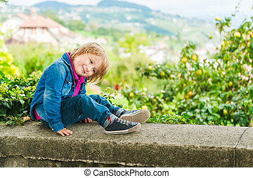 Outdoor portrait of adorable toddler boy
