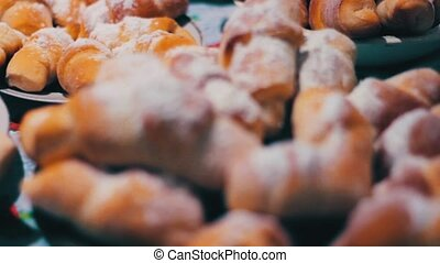 Baking on the table - Appetizing, tasty pastries, sprinkled...