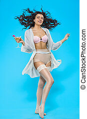 Pin-up girl - attractive girl with a martini glass in a...