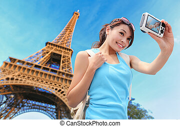 Happy travel woman in Paris with Eiffel Tower and she take a...