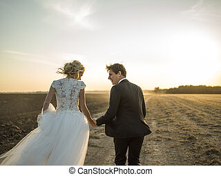 newlywed couple - dynamic picture newlywed couple running on...