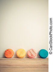 Colorful macaron with white background on wooden floor in...