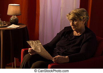Melancholic retiree reading old letter - Melancholic retiree...