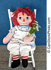 old rag doll with daisies - Old rag doll with daisy bouquet...