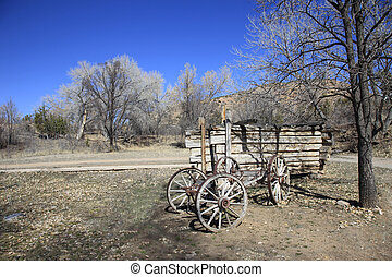 Old wagon on a ranch - An old pioneer days horse drawn wagon...