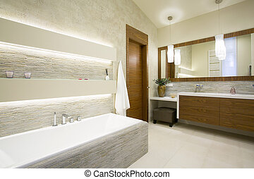 Bath and washbasin in modern bathroom interior