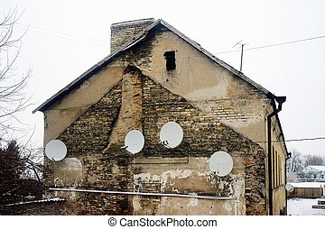 Satellite dish on the wall of a old house - VILNIUS,...