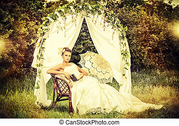 engagement - Charming elegant bride under the wedding arch...