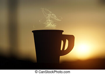 silhouette of paper coffee cup  with sunlight.