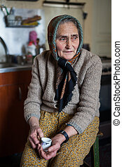Senior woman indoor - Old Romanian woman with kerchief and...