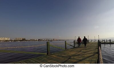 The Dock and People Silhouette