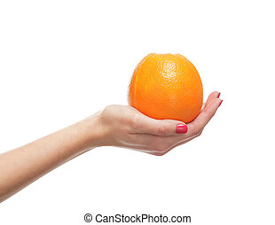 Beautiful female hands with the orange isolated on white