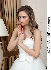 Bride - Wedding dress. Young bride tries on a wedding dress...