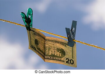 Money - 20 dollars is hanging on clothline in the air