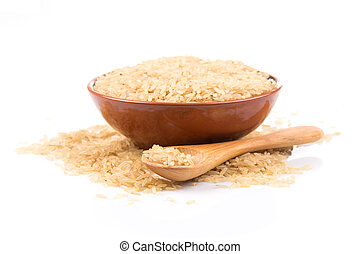 brown rice over the spoon on a white background