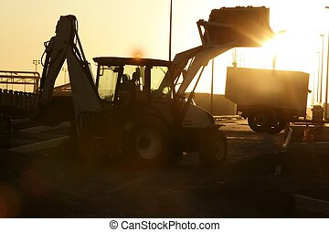 Bulldozer excavator backlight evening sunset - Bulldozer...