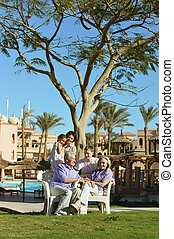 family on tropical resort - Happy family relax on tropical...