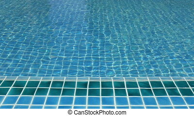 Beautiful sunny blue swimming pool
