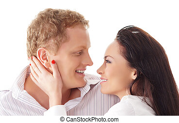 Young happy couple over white background - Young happy...