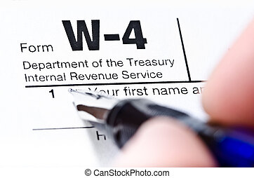 Tax Form - The process of filling out the W-4 form, shallow...