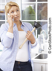 Frustrated Woman Calling Plumber To Fix Blocked Sink At Home