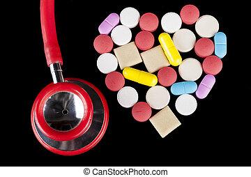 Pills Heart - Heart shape Coloerd pills medicine on black...