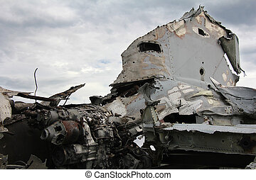 Air crash - Crashed military plane, part of the engine and...