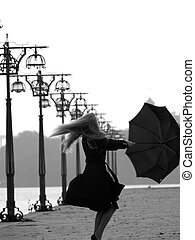 Blonde with umbrella on promenade - Beautiful blonde lady...