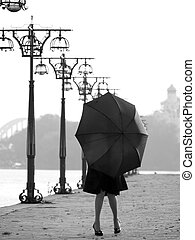 Lady with umbrella on promenade - Beautiful trendy lady with...