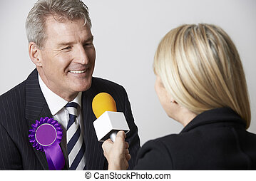 Politician Being Interviewed By Journalist During Election