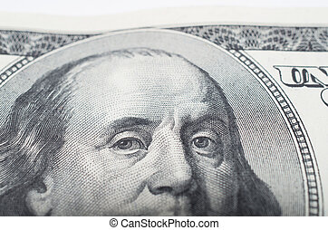 Macro close up of Benjamin Franklin's face on the US bank note,