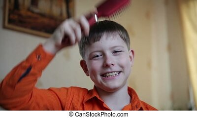 teenager boy combing head comb her hair done in the House...