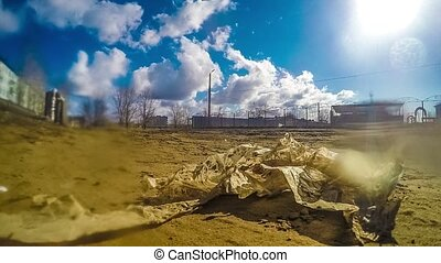 garbage bag swinging in the wind pollution earth dirt blue...