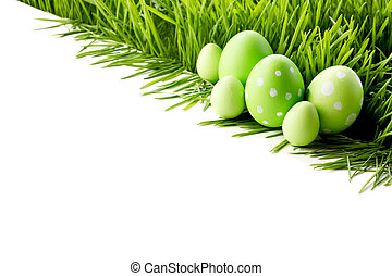 Row of Easter Eggs in grass - Row of green Easter Eggs in...