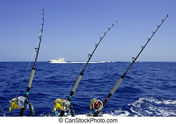 Blue sea and sky in a big game tuna fishing day rods and...