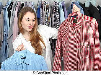 Woman in Dry cleaning with two dirty shirts