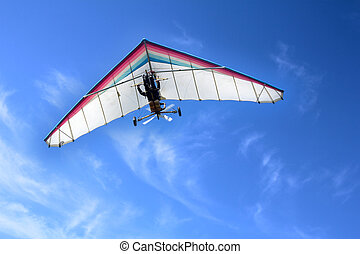 Hang glider - The motorized hang glider in the blue sky