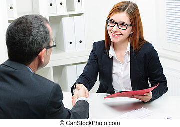 Job applicant having interview. Handshake while job...