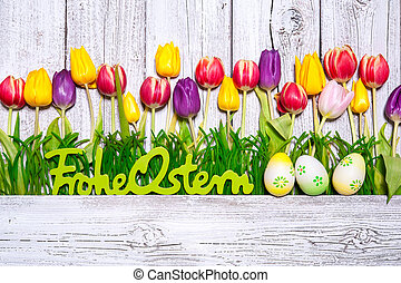 Colorful spring tulips with Easter eggs
