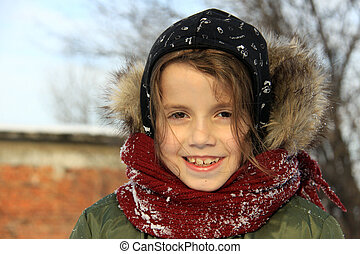 Little girl playing outdoors with snow - Preschool girl with...